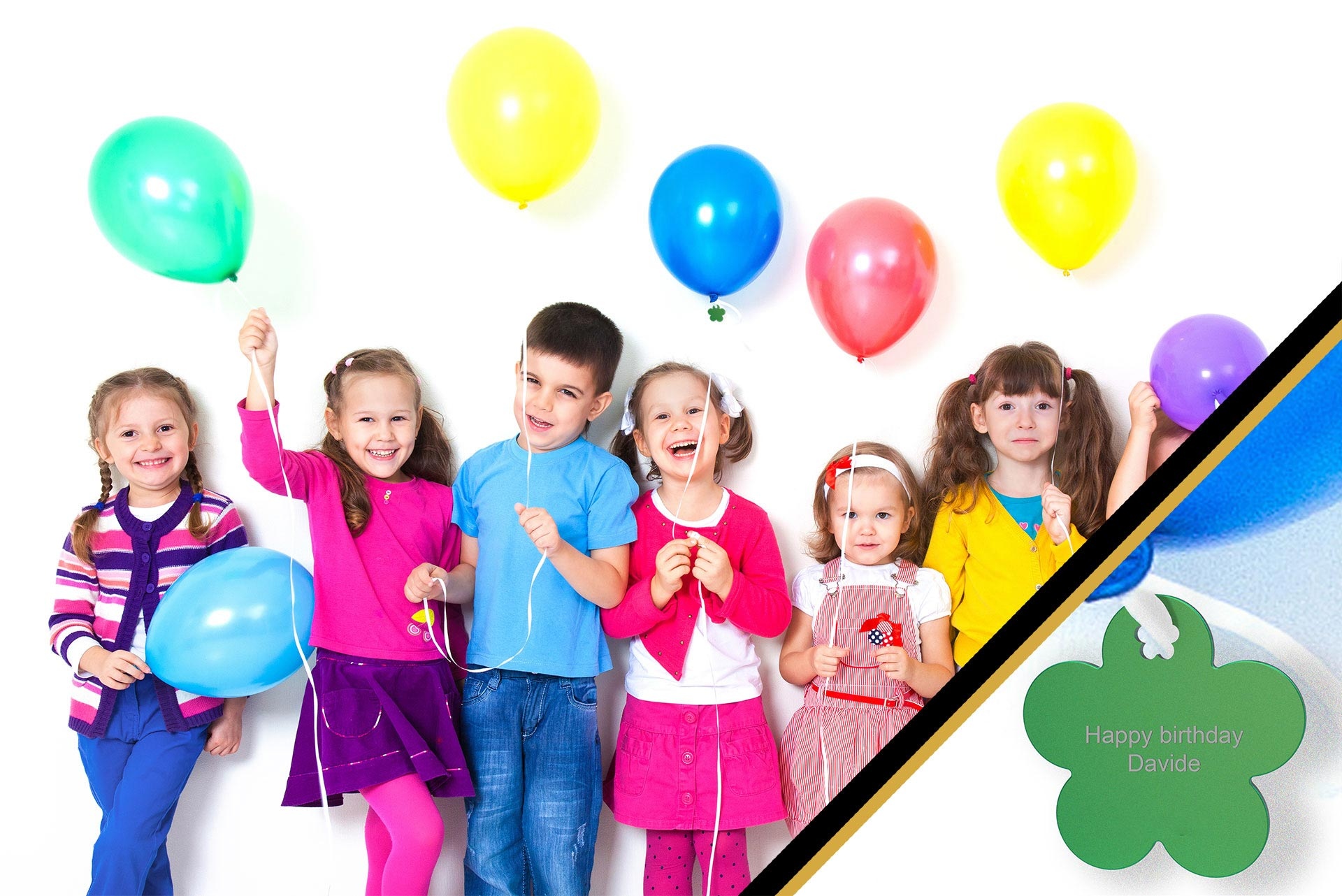 group photo of children holding balloons at a birthday party with a focus on a personalized charm