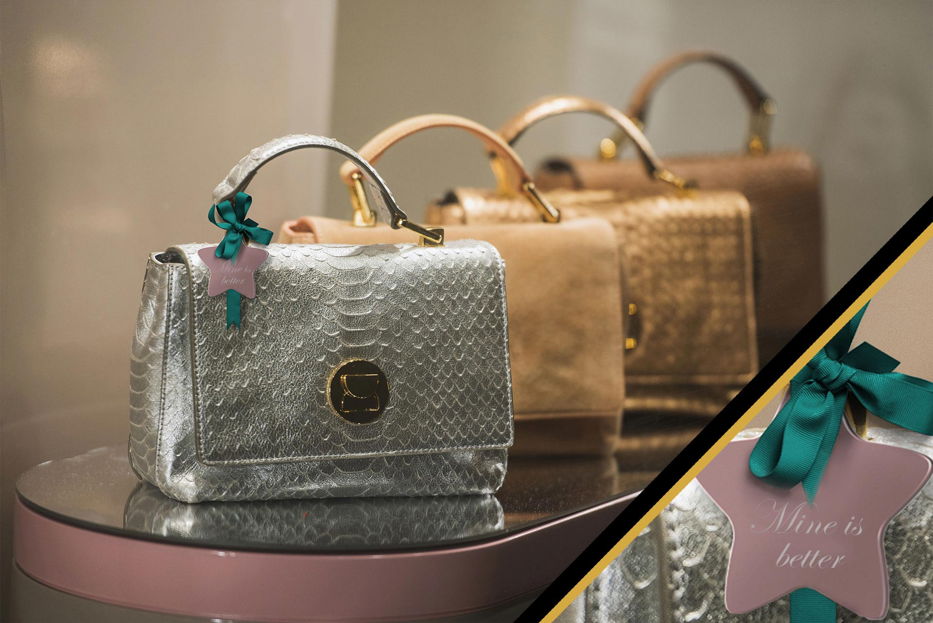 premium handbags on a display with a focus on a personalized charm hanging from a bag to luxury goods